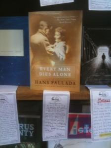 Every Man Dies Alone on display in the Elliott Bay Book Co., with Peter Aaron's handwritten shelf-talker