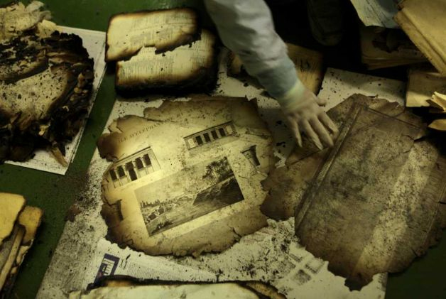 Rare books burn in Egypt, only accusations remain