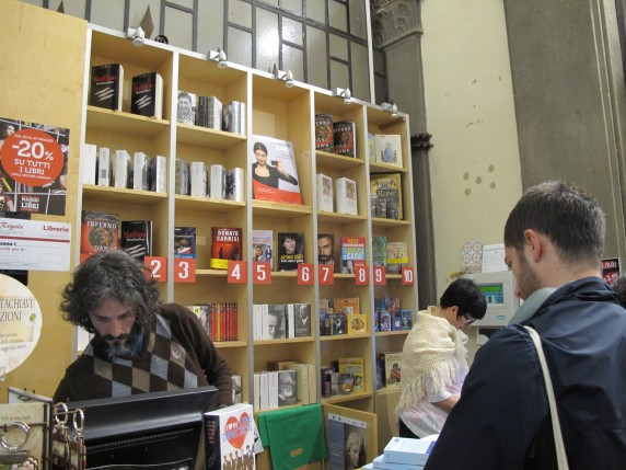 Here, books behind the counter are ranked by the store's bestsellers.
