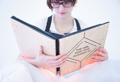 Curling up in bed with a  wearable book. Image taken from Flickr, Copyright F3H3