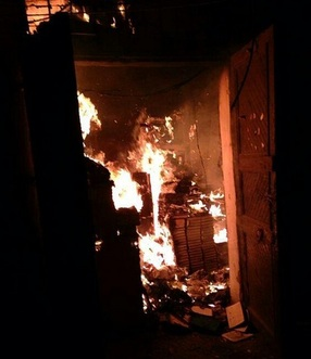 A photograph of the library in flames, posted to Twitter on January 3 by @Lara_alassaad.