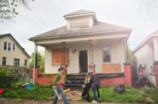 Volunteers work on renovations to one of the houses being given away by Write A House.