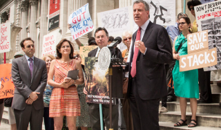 From left to right: lawyer Michael Hiller, Carolyn McIntyre and Michael White from Citizens Defending Libraries, and Mayor Bill de Blasio.