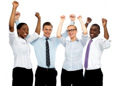 "A generic stock photo of ""happy employees"", via Shutterstock."