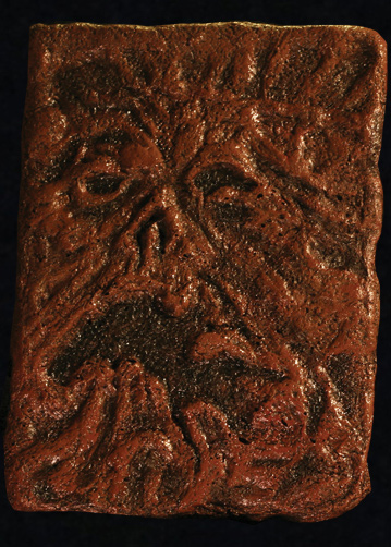 Evil Dead's Necronomicon is probably the most famous human-bound book. (This one is a prop, available for sale by Trick or Treat Studios.)