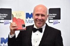 Richard Flanagan with a book he's probably not going to burn.