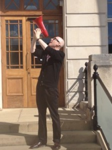 David Peace spreading the word with Red Ladder's red megaphone.