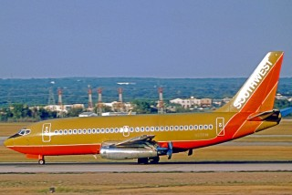 A 1975 photo of a very brown Boeing 737. (Southwest's livery is now considerably less brown.) (via Wikimedia Commons)